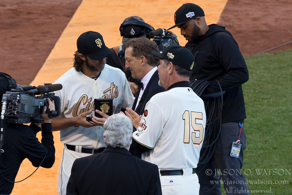 SAN FRANCISCO, CA - APRIL 18:  Madison Bumgarner #40 of the San Francisco Giants is presented with a World Series ring by Larry Baer and manager Bruce Bochy #15 during the 2014 World Series ring ceremony before the game against the Arizona Diamondbacks at AT&T Park on April 18, 2015 in San Francisco, California.  The San Francisco Giants defeated the Arizona Diamondbacks 4-1. (Photo by Jason O. Watson/Getty Images) *** Local Caption *** Madison Bumgarner; Larry Baer; Bruce Bochy