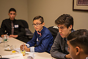 Purchase, NY – 31 October 2014. Yonkers High School student Antonio Modesto, second from right, listeniing to a team member. The Business Skills Olympics was founded by the African American Men of Westchester, is sponsored and facilitated by Morgan Stanley, and is open to high school teams in Westchester County.