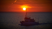 RV EGS Pioneer at Sunrise in the English Channel from the Deck of the MV Explorer. Semester at Sea, Summer 2014 Voyage. Image taken with a Nikon Df camera and 70-200 mm f/4 VR lens (ISO 400, 200 mm, f/16, 1/250 sec). Raw image processed with Capture One Pro, Focus Magic and Photoshop CC 2014.