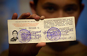 Marc Piscotty/News Staff Photographer<br /> SHOT 11/09/2002 - Fourteen year-old Ilshad Zhigandarov displays a government i.d. card certifting him as a victim of radiation. Zhigandarov and his family were evacuated from their home along the Techa River and now live in nearby Kunashak. He has epilepsy, which the family believes is related to exposure to radiation, and his father died of bone disease. Ilshad's grandmother, grandfather, aunt and father have all died of cancer.