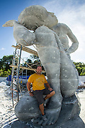 "Ocean Atlas<br /> <br /> Installed at the beginning of October 2014 on the western coastline of New Providence in Nassau, Bahamas, ""Ocean Atlas"" references the Ancient Greek sculpture of Titan Atlas holding the heavens but depicts a young local Bahamian girl sustaining the ceiling of the ocean. The largest single sculpture ever to be deployed underwater, it reaches from the sea floor five meters up to the surface and weighs over sixty tonnes. Assembled underwater in sections using an ambitious new technique developed and engineered by Jason deCaires Taylor.<br /> <br /> The sculpture commissioned by B.R.E.E.F (Bahamas Reef Environment Educational Foundation) aims to create an underwater sculpture garden in honor of its founder Sir Nicholas Nuttall. It includes other sculptural works by local artists Willicey Tynes and Andret John and an artificial reef trail designed by Reefball.<br />  <br /> The new work, which during low tide will reflect a mirror image on the underside of the sea's surface, is a dramatic increase in scale from Taylor's previous works and ensures that even after substantial coral growth the figure will still remain highly recognisable. A solar light and flag is located on the highest point to aid marine navigation.<br /> <br /> Constructed using sustainable pH neutral materials it creates an artificial reef for marine life to colonise and inhabit, whilst drawing tourists away from over stressed natural reef areas. <br /> <br /> With our oceans and coral reefs currently facing collapse from numerous threats including; overfishing, habitat loss, ocean acidification, global warming and water pollution the piece symbolizes the burden we are currently asking future generations to carry and the collective responsibility we have to prevent its collapse.<br /> ©Jason deCaires Taylor/Exclusivepix"