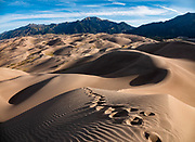 In morning light, dunes rise up to 750 feet tall in Great Sand Dunes National Park and Preserve, on the eastern edge of San Luis Valley, Sangre de Cristo Range, south-central Colorado, USA. This image was stitched from multiple overlapping photos.
