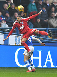 Birmingham City's David Davisout jumps Sheffield Wednesday's Morgan Fox