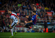 Suarez shoots the ball acrobatically in front Galvez of R. Vallecano during the Spanish league football match of 'La Liga'  FC BARCELONA against RAYO VALLECANO at Camp Nou Stadium of Barcelona on March 9,2019