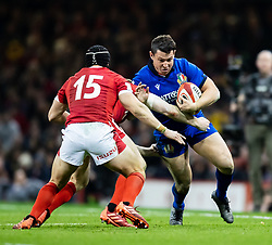 Carlo Canna of Italy under pressure from  George North of Wales<br /> <br /> Photographer Simon King/Replay Images<br /> <br /> Six Nations Round 1 - Wales v Italy - Saturday 1st February 2020 - Principality Stadium - Cardiff<br /> <br /> World Copyright © Replay Images . All rights reserved. info@replayimages.co.uk - http://replayimages.co.uk