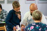 Bialystok, 17.11.2019. Prezentacja gry planszowej wydanej przez Bialostocki Osrodek Kultury HONOROWY OBYWATEL, ktorej przebieg toczy wokol wizyty Marszalka Jozefa Pilsudskiego 21 sierpnia 1921 roku w Bialymstoku. Gracz ma zdobyc jak najwiecej punktow chwaly poprzez uczestnictwo lub organizacje w wizycie Pilsudskiego N/z gracze przy grze fot Michal Kosc / AGENCJA WSCHOD
