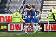Chris McCann of Wigan Athletic (c) celebrates with his teammates after scoring his teams 1st goal. Skybet football league one match , Wigan Athletic v Southend Utd at the DW Stadium in Wigan, Lancs on Saturday 23rd April 2016.<br /> pic by Chris Stading, Andrew Orchard sports photography.