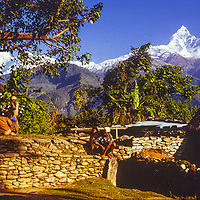 Machapuchhare Peak towers above a village in the Pokhara Valley in Nepal.