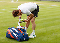 Tennis - 2019 Queen's Club Fever-Tree Championships - Day Three, Wednesday<br /> <br /> Men's Singles, First Round: Juan Martin Del Potro (ARG) Vs. Denis Shapovalov (CAN)<br /> <br /> Andy Muray (GBR) bends down to his kit bag on Centre Court.<br />  <br /> COLORSPORT/DANIEL BEARHAM