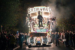 © Licensed to London News Pictures. 12/11/2014. Shepton Mallett, UK The carnival makes it way through Shepton Mallett on 12th November 2014. The carnival is widely regarded as one of the largest illuminated processions in the world. A trail of breath taking carts parade through towns in Somerset in November as part of a tradition which dates back to the Gunpowder Plot  on the Houses of Parliament in 1605. The 2 week-long spectacle can draw crowds of up to 150,000 and sees hundreds of entries from across the county. Dedicated members of the numerous carnival clubs who take part design and build carts in secrecy, some of the carts costs thousands of pounds to build , most of the money raised in charity events  in a bid to win awards for the best carts.  The specially-designed carts measure up to 100ft long, feature state-of-the-art electronics and hydraulics, and are decorated with thousands of light bulbs. The Last carnival this year will be at Glastonbury on Saturday night and a crowd is expected of 100 000 people to watch the three hour event. Photo credit : Jason Bryant/LNP