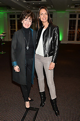Left to right, KIRSTEN GRENSIDE and EMILY CAILLON-CHENE at a film screening in aid of the charity Women for Women held at BAFTA, 195 Piccadilly, London on 26th February 2014.