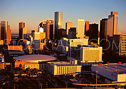 Aerial view of the downtown Houston, Texas skyline featuring the Toyota Center, Hilton Americas-Houston, and the George R. Brown Convention Center.