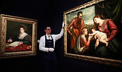 © under license to London News Pictures. A portrait of Laura Pisani by Calzolaretto and Titian's A Sacra Conversazione: The Madonna and Child with Saints Luke and Catherine of Alexandria for sale in New York on 27/01/11. Sotheby's sale of Old Master & British Paintings in London and New York, photographed at Sotheby's on 03/12/10 Photo credit should read: Olivia Harris/ London News Pictures