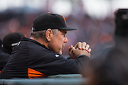 San Francisco Giants manager Bruce Bochy (15), left, watches from the dugout while the San Francisco Giants host the New York Mets at AT&T Park in San Francisco, Calif., on August 21, 2016. (Stan Olszewski/Special to S.F. Examiner)