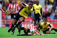 Thierry Henry (Arsenal) tripped by Sunderland defender Stanislav Varga. Sunderland 1:0 Arsenal, 19/8/2000. Credit Colorsport / Stuart MacFarlane