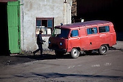 Man getting into a UAZ 452 Bukhanka van in Barentsburg, a Russian coal mining town in the Norwegian Archipelego of Svalbard. Once home to about 2000 miners and their families, less than 500 people now live here.