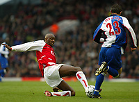 Photo. Chris Ratcliffe<br />Arsenal v Blackburn Rovers. FA Premiership. 14/12/2003<br />Patrick Viera goes in hard on Brett Emerton