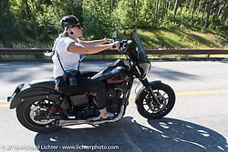 Oklahoma City photographer Staci Wilt riding her FXR Dyna on the Harley-Davidson Angels Ride to benefit the Nature Conservancy during the annual Sturgis Black Hills Motorcycle Rally.  SD, USA.  August 12, 2016.  Photography ©2016 Michael Lichter.
