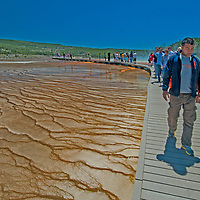 Tourists hike on a boardwalk beside Grand Prismatic Spring - North America's largest hot spring - in Wyoming's Yellowstone National Park.