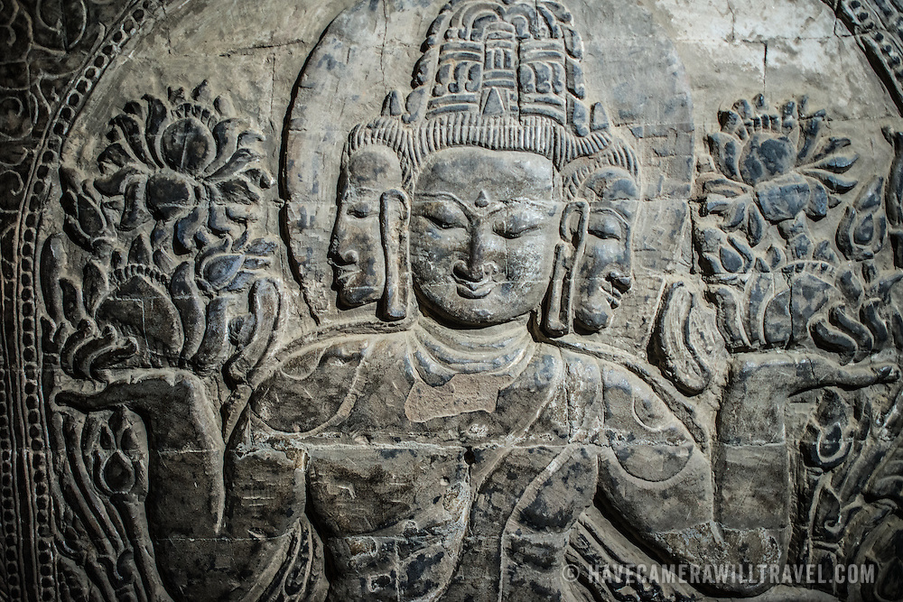 An etching of a three-faced Buddha carved in stone at Nan Hpaya, a small temple with a shrine that dates back to the 11th century in the Bagan Archeological Zone, Bagan, Myanmar (Burma).