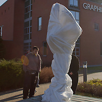 First ever life-size bronze statue of late Apple leader Steve Jobs covered with white textile in its final place in front of the Graphisoft building in Budapest, Hungary on December 13, 2011. ATTILA VOLGYI