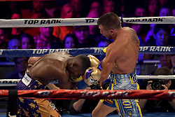 December 9, 2017 - New York, New York, USA - GUILLERMO RIGONDEAUX (gold and purple trunks) and VASILIY LOMANCHENKO battle in a junior lightweight WBO World Title bout at Madison Square Garden in New York City, New York. (Credit Image: © Joel Plummer via ZUMA Wire)