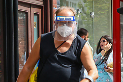 "© Licensed to London News Pictures. 24/05/2020. London, UK. A man wearing a visor walks past a Turkish restaurant on Green Lanes, Haringey in north London which is open for take away only due to coronavirus lockdown, as Muslims celebrate Eid al-Fitr.  On Eid al-Fitr also known as ""Festival of Breaking the Fast"", a religious holiday celebrated by Muslims worldwide that marks the end of the month-long fasting of Ramadan, restaurants would normally be packed with people celebrating Eid. Photo credit: Dinendra Haria/LNP"