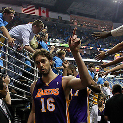 April 28, 2011; New Orleans, LA, USA; Los Angeles Lakers power forward Pau Gasol (16) celebrates following a win over the New Orleans Hornets in game six of the first round of the 2011 NBA playoffs at the New Orleans Arena. The Lakers defeated the Hornets 98-80 to advance to the second round of the playoffs.   Mandatory Credit: Derick E. Hingle