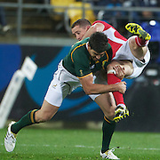 Huw Bennett, Wales, is tackled by Jaque Fourie, South Africa, (left) during the Wales V South Africa, Pool D match during the Rugby World Cup in Wellington, New Zealand,. 11th September 2011. Photo Tim Clayton