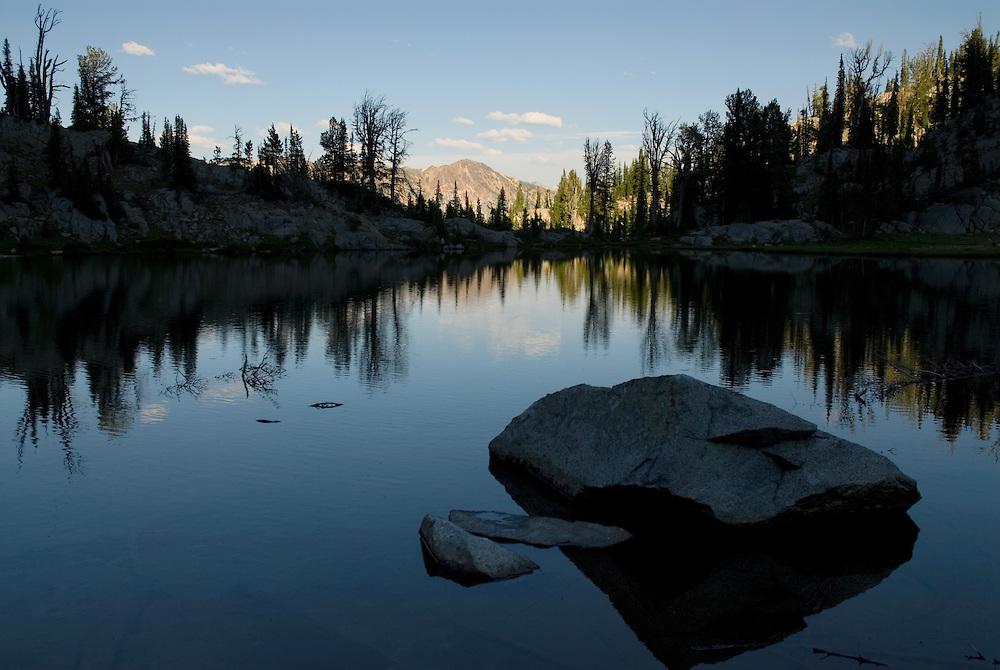 Evening reflection in Laverty Lake, Wallowa Mountains, Oregon.