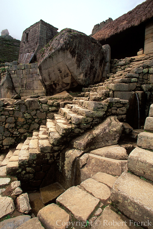 PERU, HIGHLANDS, PREHISPANIC, INCA Machu Picchu; the Temple of the Sun beyond and a series of fountains in the foreground