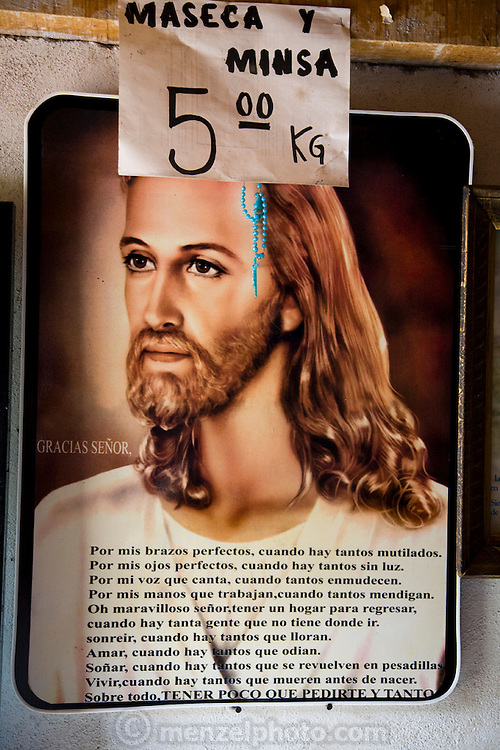 A poster of Jesus with a prayer written on it hangs in a small food store in Maycoba, in the Mexican state of Sonora. MODEL RELEASED.