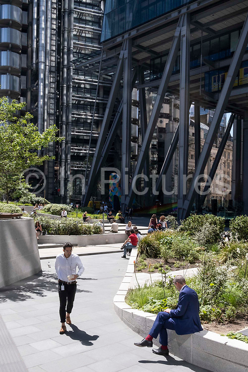 Office workers enjoy a sunlit lunch-hour at Leadenhall in the City of London, the capitals financial district, on 8th June 2021, in London, England.