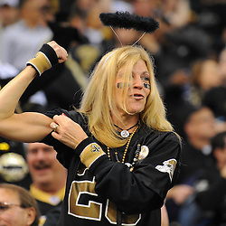 16 January 2010:  A New Orleans Saints fan in the stands during a 45-14 win by the New Orleans Saints over the Arizona Cardinals in the 2010 NFC Divisional Playoff game at the Louisiana Superdome in New Orleans, Louisiana.