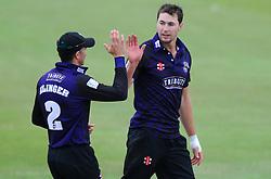 James Fuller of Gloucestershire celebrates with Michael Klinger of Gloucestershire  - Photo mandatory by-line: Dougie Allward/JMP - Mobile: 07966 386802 - 14/07/2015 - SPORT - Cricket - Cheltenham - Cheltenham College - Natwest T20 Blast