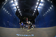 Joe Lee of England (in the grey shirt) warms up for his match against Mathieu Castagnet of France . Canary Wharf Squash Classic 2016 , day two at the East Wintergarden in Canary Wharf , London on Tuesday 8th March 2016.<br /> pic by John Patrick Fletcher, Andrew Orchard sports photography.