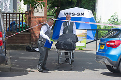 ©Licensed to London News Pictures 12/07/2020     <br /> Penge, UK. The body is removed from the scene by private ambulance staff. Police detectives from specialist crime and investigation are appealing for witnesses after a murder in Penge, South East London in the early hours of Sunday morning. A crime scene cordon is in place. Photo credit: Grant Falvey/LNP