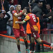 Galatasaray's celebrates his goal Burak Yilmaz, Selcuk inan (L-R) during their UEFA Champions League Group H matchday 3 soccer match Galatasaray between CFR Cluj at the TT Arena Ali Sami Yen Spor Kompleksi in Istanbul, Turkey on Tuesday 23 October 2012. Photo by Aykut AKICI/TURKPIX