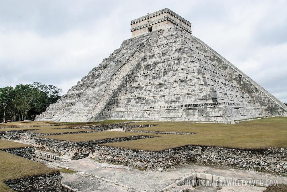 Pyramid of Temple of Kukulkan (El Castillo) at Chichen Itza Archeological Zone, ruins of a major Maya civilization city in the heart of Mexico's Yucatan Peninsula.