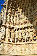 Tympanum of central west portal: scenes of the Day of Judgement, supported by an array of saints.  Gothic Cathedral of Notre-Dame, Amiens, France . The Cathedral Basilica of Our Lady of Amiens or simply Amiens Cathedral, is a Roman Catholic  cathedral the seat of the Bishop of Amiens. It is situated on a slight ridge overlooking the River Somme in Amiens. Amiens Cathedral, was built almost entirely between 1220 and c.1270, a remarkably short period of time for a Gothic cathedral, giving it an unusual unity of style. Amiens is a classic example of the High Gothic style of Gothic architecture. It also has some features of the later Rayonnant style in the enlarged high windows of the choir, added in the mid-1250s. Amiens Cathedra has been listed as a UNESCO World Heritage Site since 1981. Photos can be downloaded as Royalty Free photos or bought as photo art prints. <br /> <br /> Visit our MEDIEVAL PHOTO COLLECTIONS for more   photos  to download or buy as prints https://funkystock.photoshelter.com/gallery-collection/Medieval-Middle-Ages-Historic-Places-Arcaeological-Sites-Pictures-Images-of/C0000B5ZA54_WD0s