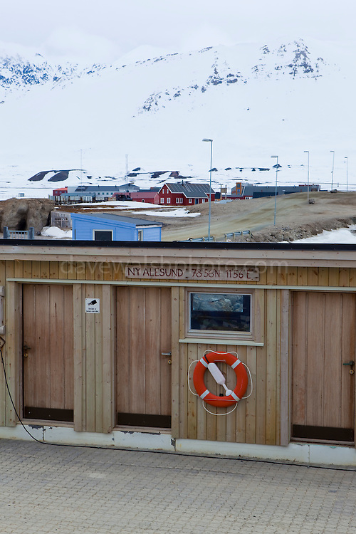 Sign marking 78 degrees 56 minutes north at the international scientific research base of Ny Alesund, Svalbard. Ny Alesund is one of the world's most northerly settlements, and  the northernmost functional public settlement.