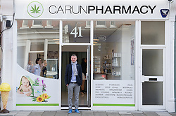 © London News Pictures. 15/05/15. London, UK. Michal Takac, MD of Carun UK stands outside the UK's first cannabis pharmacy, Twickenham, West London. Carun UK, which will be based in Twickenham, London, aims to 'harness the healing super-powers of hemp' which is claims is the 'ultimate skin saviour and well-being booster'. Photo credit: Laura Lean/LNP