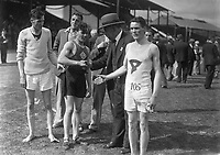 H2608<br /> Aonach Tailteann Athletics. Man being congratulated. 1932 (Part of the Independent Newspapers Ireland/NLI Collection)