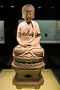 Ceramic Buddha figure on display in the Shanghai Museum, China