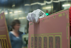 Close-up of man engineer hand holding circuit board in industry, Hanover, Lower Saxony, Germany