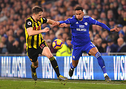 Watford's Craig Cathcart (left) and Cardiff City's Josh Murphy battle for the ball during the Premier League match at the Cardiff City Stadium.
