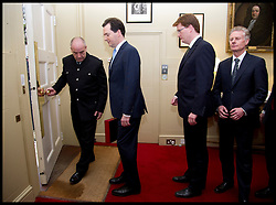 The Chancellor of the Exchequer George Osborne and Danny Alexander (middle) wait to step out of No11 Downing Street to face the photographers with his  red Budget Box as he goes to the House of Commons to deliver the 2013 Budget, Wednesday March 20, 2013 Photo By Andrew Parsons / i-Images