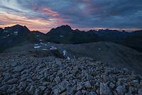 View across rocky summit of Støvla towards Hermannsdalstind, Moskenesøy, Lofoten Islands, Norway