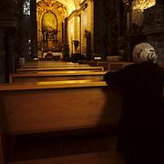 Elderly woman praying on the morning of Good Friday