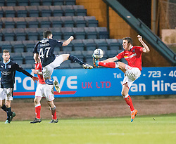 Dundee's Alex Harris and Ross County's Filip Kiss. <br /> Dundee 1 v 1 Ross County, SPFL Premiership game player 4/1/2015 at Dundee's home ground Dens Park.